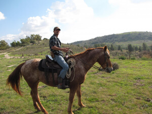 Yuval Sharabi riding a horse