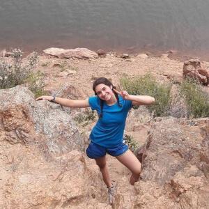 Tamar Moss climbing rocks